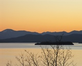 Sunset behind the Adirondacks across Lake Champlain. Photo credit: Elissa Schuett